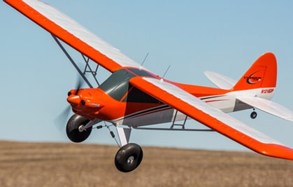 Large Field and Club representative airplane flying